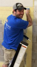 Pastor Troy Picou adds a fresh coat of paint