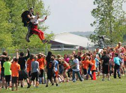 Students flock around their principal