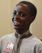 Crestwood Middle School student James Ngabo sports his new tie