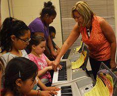 Comstock Park Elementary School music teacher Amanda Hite teaches her students piano