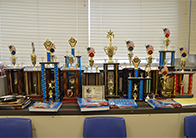 """""""We the People"""" trophies line the wall in Janice Yates' classroom"""
