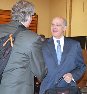 Jamie Vollmer talks to audience members following his speech to business leaders at Kent ISD