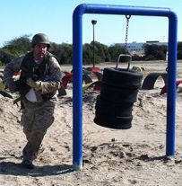 Wyoming Public Schools Superintendent Tom Reeder completes an obstacle course at the Military Corps Educators Workshop