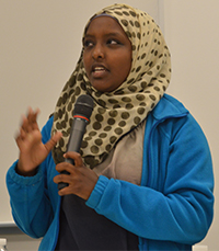 Nashteha Feto, an East Kentwood High School junior, speaks of challenges faced by refugee families