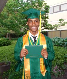 Gloire Rubambiza with his diploma after graduating