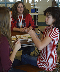 Jocelyn Noviskey, Hilary Edema, a paraprofessional at Thornapple Kellogg Middle School, and Maggie Maring talk during lunch