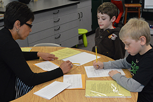 Second grade Emmons Lake Elementary School teacher Fran Hollern works with students Mitchell Shippy-Thrash and Pierson Reiffer. Emmons Lake has a year-round calendar