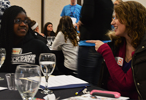 Comstock Park High School sophomore Inga Esese chats with advisor Gina Boscarino about an action plan