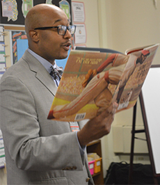 Mentor Gary Harmon, Pinewood Middle School principal, reads to Bowen Elementary School students