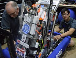 Wyoming High School junior Ted Tran works on the team's robot
