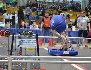 Wyoming High School team's Robot 858 prepares to launch a ball