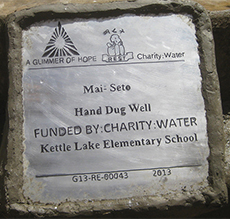 The sign on the well in Mai-Seto, Ethiopia, honors Kettle Lake Elementary for helping raise money to build it
