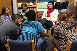 Ninth-grade student Amra Rahmic uses her leadership skills with a group of volunteers who helped create an anti-cyberbullying presentation to teach fifth graders about Internet safety