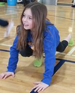 Fifth grader Laura Hulburt smiles while she stretches