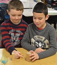 Students Zachary Shock and Juan Jimenez-Hernandez play with geometric shapes