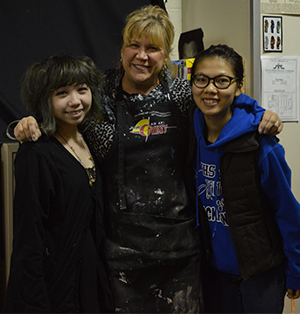 Kelloggsville art students Kassie Nguyen and Linh Le pose with art teacher Donna Casmere.  Linh recently won a Michigan Art Education Association state award and Kassie won a MAEA Regional Award and Scholastic Writing and Art awards.