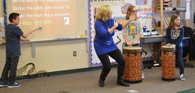 Music teacher Amanda Hite uses an interactive projector in her class