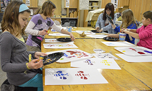 Fifth-grade student Kate Van Dyke makes a butterfly print