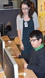 KSSN coordinator Brianna Vasquez checks on students during an after-school session