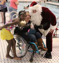 Santa spends about an hour meeting with children before jumping in
