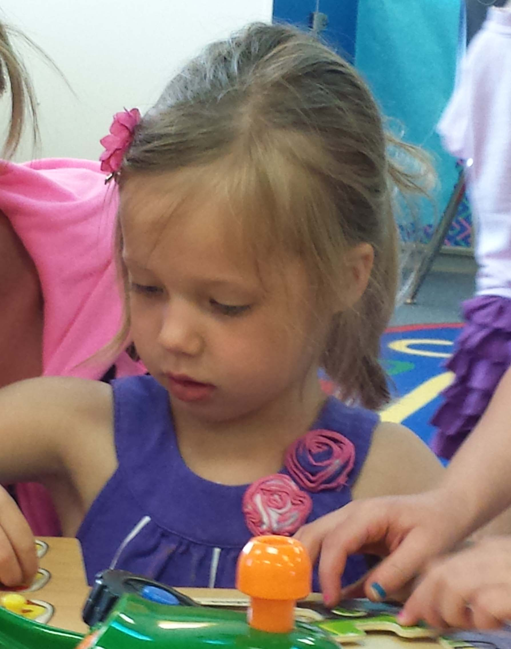 Taylor Gunderson, 4, works on a puzzle in a play group at Cedar Trails Elementary School