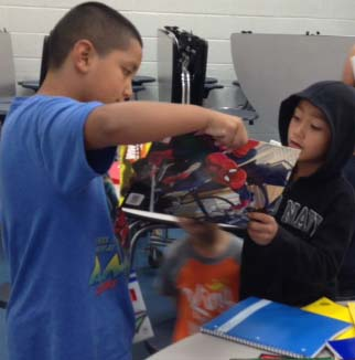 Brothers Oscar and Omar Estrada pick school supplies during a give away at Godfrey Lee Elementary's Open House last week
