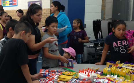 Students choose school supplies during a give away at Godfrey Lee Elementary's Open House last week