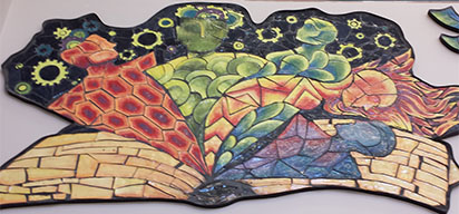 Panels high on the library walls symbolize the fanciful figures of readers' imaginations
