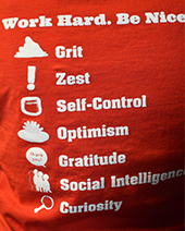 Tech 21 Academy T-shirts list the seven character principles students are taught to exhibit