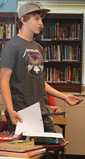 Gage Heyboer argues a point in a world history class debate