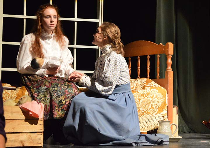 """Morgan Maggini (left) as Helen Keller and Hannah Moore as her teacher, Annie Sullivan, in a scene from """"The Miracle Worker"""""""