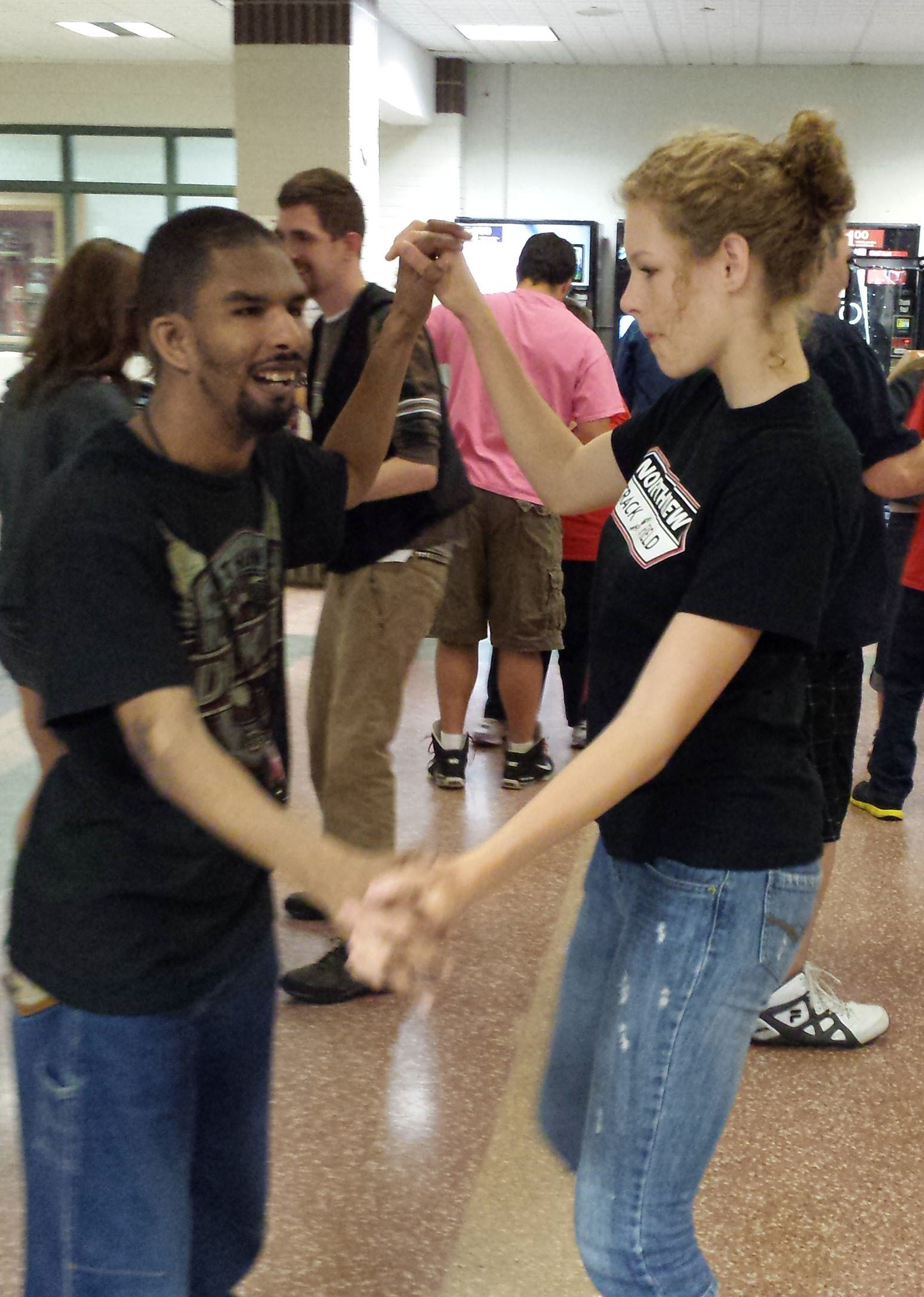 Northview senior Kendra Campbell twists the night away with Troy, a student from the Kent Vocational Options program.