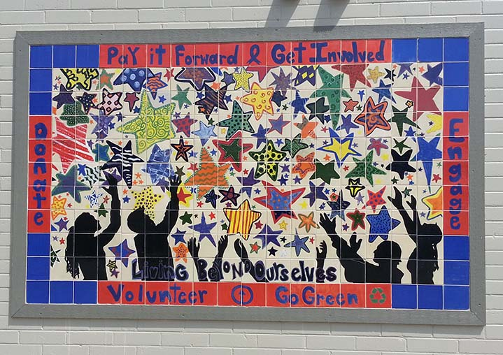 A student-created mural hangs outside The Dock.