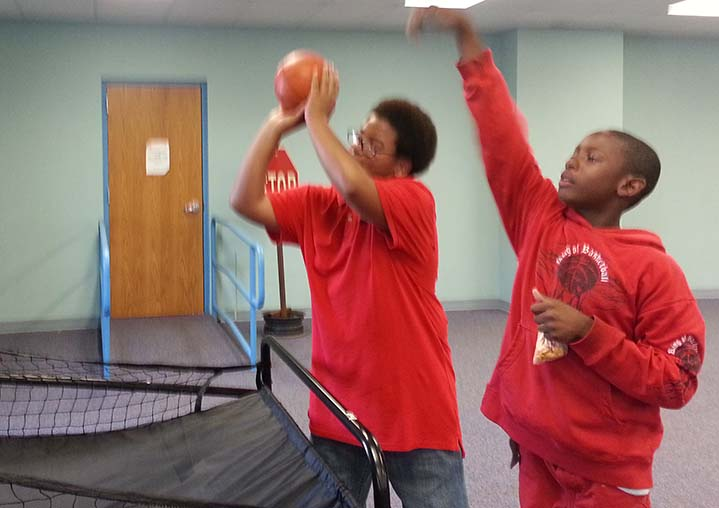 Desmond Simmons and Jawan Walton shoot hoops