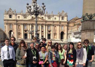 Comstock Park World History Teacher Betsy Rybarczyk and her students in Vatican City