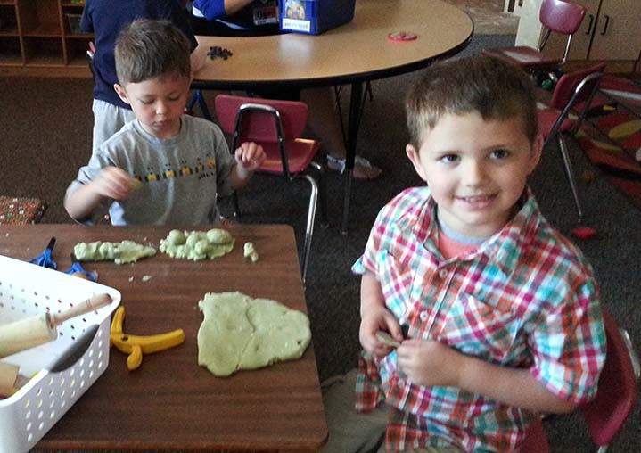 Great Start Readiness Program students work with play dough in their West Oakview preschool class