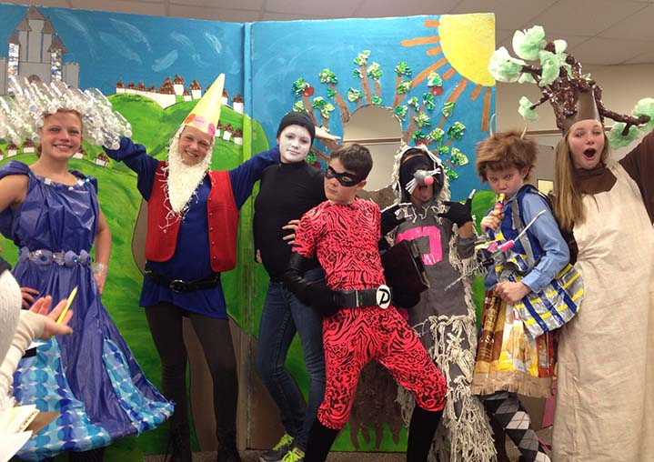 Thornapple Kellogg Middle School Odyssey of the Mind team poses after performing their play during the World Finals at Michigan State University last weekend