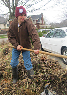 """East Grand Rapids Middle School sixth grade Teddy Drake lends a hand during """"Spring Greening."""""""