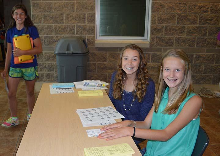 Eighth-graders Kiersten Woudsta and Janelle Baar greet new seventh graders at Byron Center West Middle School