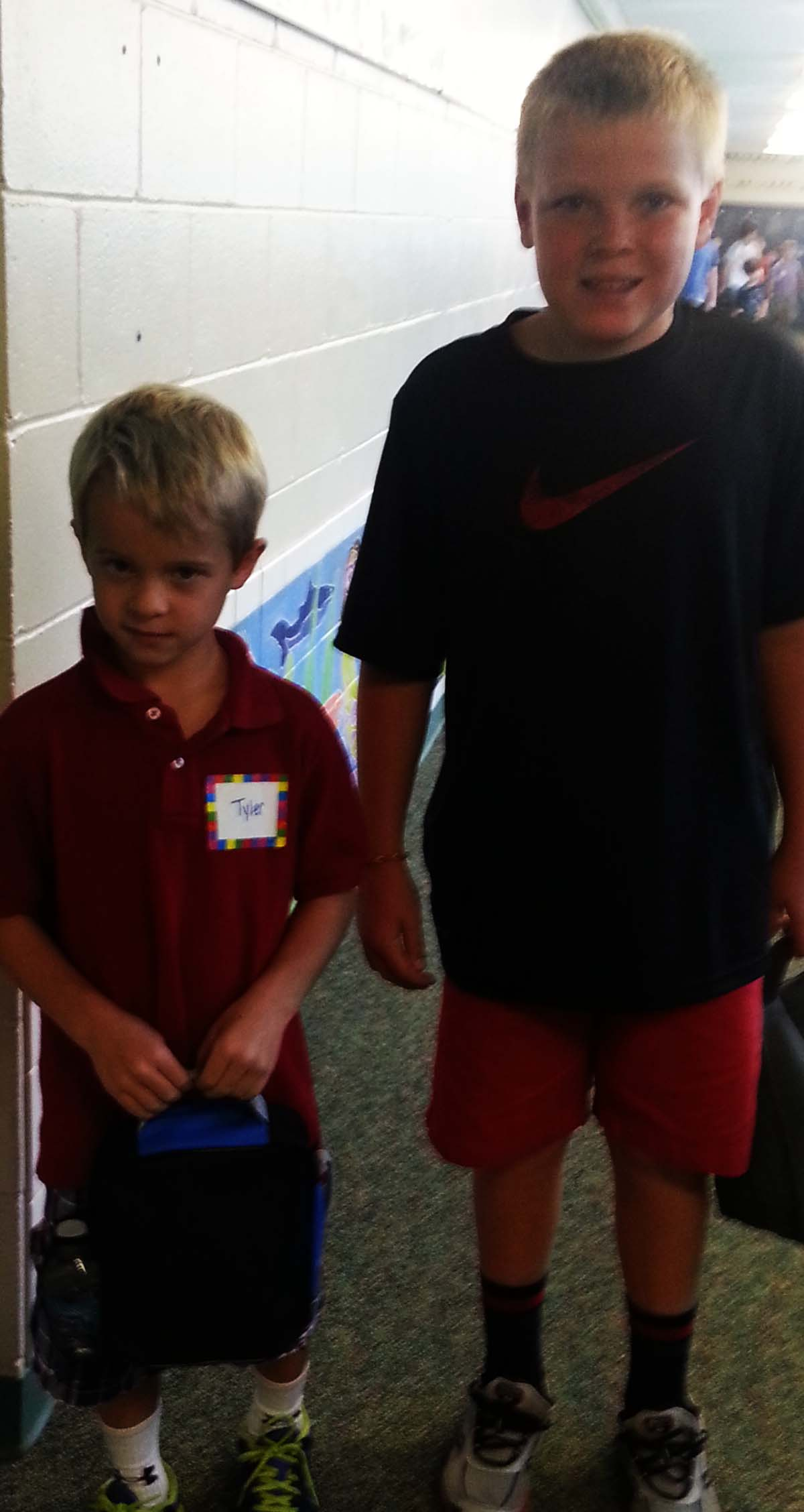 Fifth-grade student Ted Campbell walks with Tyler Blake down to the lunchroom