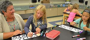 Linda Kehm stops in the Lakeside Elementary art class