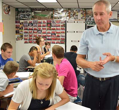 High School math teacher Mark Thompson instructs students
