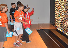 """Sixth grade students dance to create movement in front of artist Daniel Rozin's ArtPrize entry """"Trash Mirror"""""""