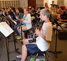 The Kent City Middle School band practices under the leadership of Director Jonathan Schnicke