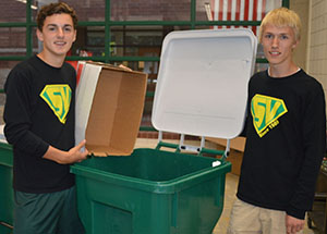 Seniors Justin Terveen  and Nolan Rossman collect recycling to support the student volunteer team