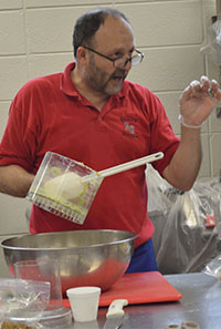 Mo Shamali demonstrates how to make falafel, a deep-fried ball or patty made from ground chickpeas, fava beans or both