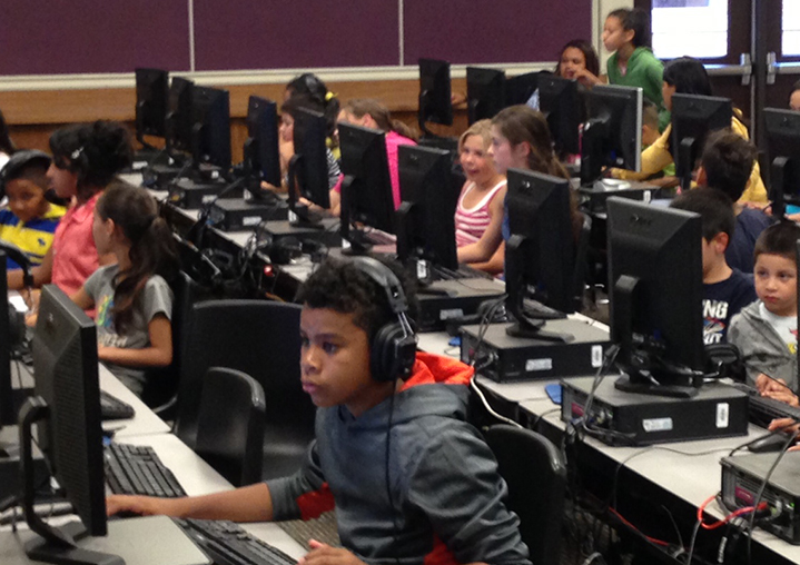 Children explore the computer lab while their parents talk to administrators at a recent parent night