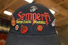 Proud veterans wore hats that showed where they had served, such as this one Richard Frank wore