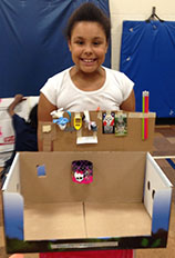 Makayla Thocher shows off her basketball arcade game (cr. Kelly Hammontree)