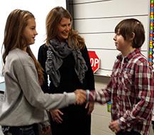 Mykayla Vallad welcomes Devon to U.S. history class along with teacher Angie Ohlman